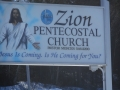 Sign at entrance to Pentecostal  Church in Northwest Brook. (Photo by Lester Green)