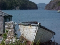 View of entrance to Little Heart's Ease harbour with Guy Drodge's old trapskiff in the foreground. (Photo by Lester Green, 2002)