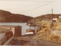 wThe old Co-op saltfish storeage shed (LHE), along with the shed where fishermen bought fuel. (Donated by Lester Green)