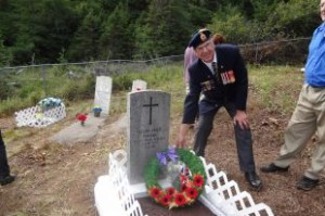 Clarenville Legion Past President, Wesley Stringer, lays a wreath on the restored grave of World War 1 veteran Elijah Price, who is laid to rest at Loreburn.