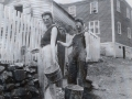 Annie Blanche Smith and Kay Doyle Liming the fence at her fathers home Joseph Edward Seward